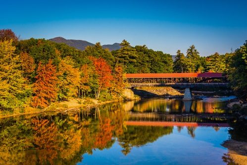 fall foliage at Saco River Covered Bridge in Conway, New Hampshire.