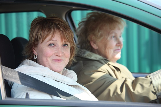 two women in car. An older woman driver with a younger woman.