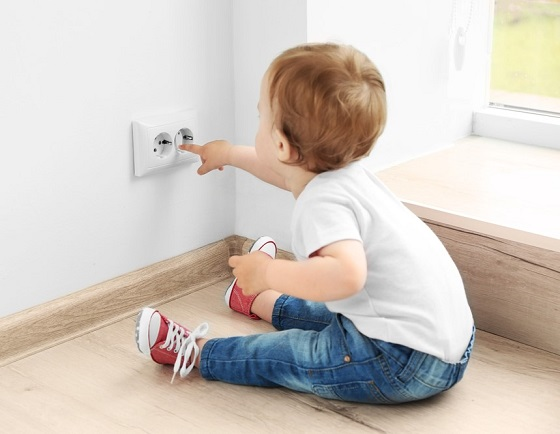 child playing with electrical outlet