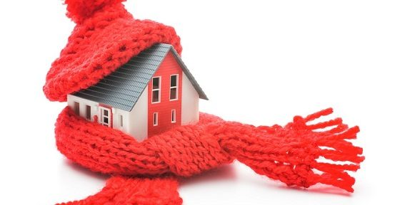 house wrapped in a sweater to illustrate energy efficiencycy