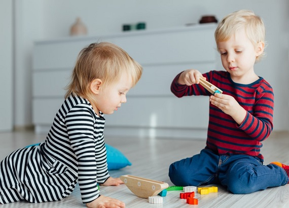 children playing with toys to illustrate toy safety