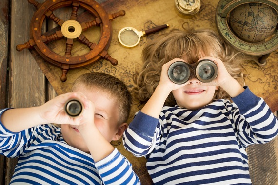 children looking through nautical glasses