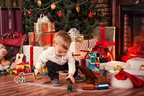 young boy with Christmas toys