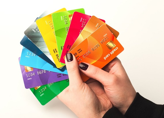 woman's hand holding colorful prepaid debit cards