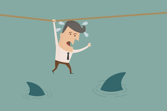 cartoon of a business man hanging on to a rope above swimming sharks