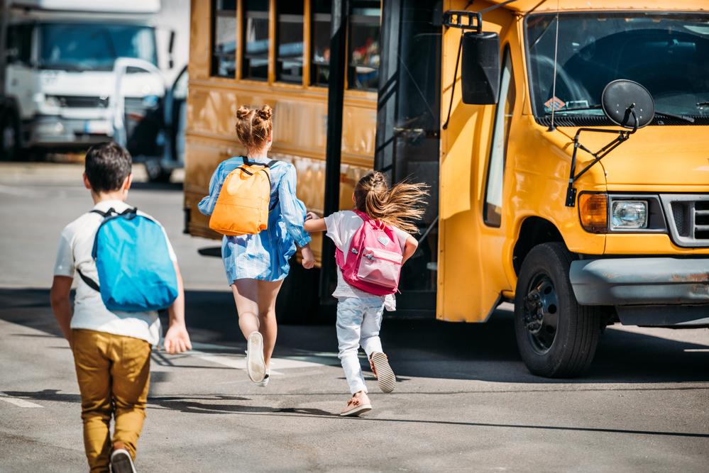 school bus safety - kids getting on a school bus