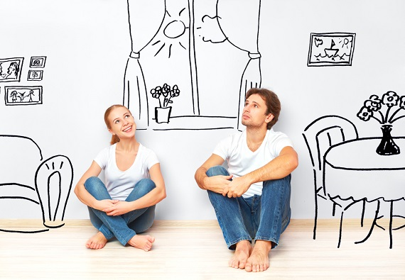couple sitting on floor imagining their new home