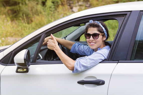 woman driver giving thumbs up