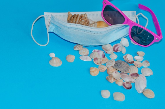 sea shells, sunglasses and a facial mask_ beachgoing in the pandemic